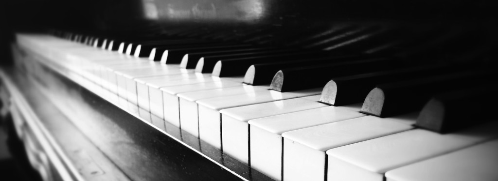 A close up of the keys of an antique piano